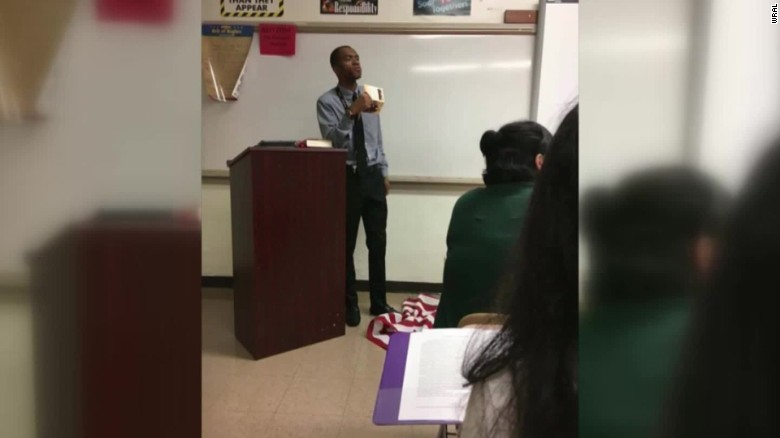 Teacher suspended after stepping on American flag