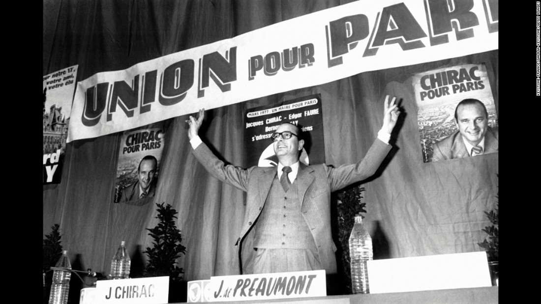 Chirac responds to cheers after being elected mayor of Paris in 1977.