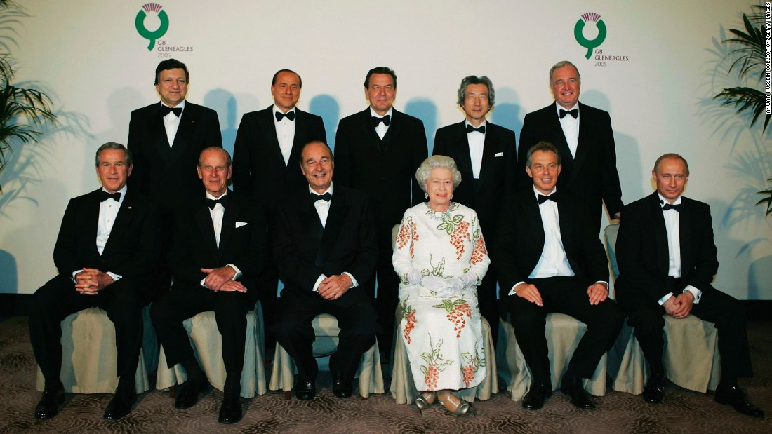 Chirac sits next to Britain's Queen Elizabeth II during a group photo with G-8 leaders in 2005.