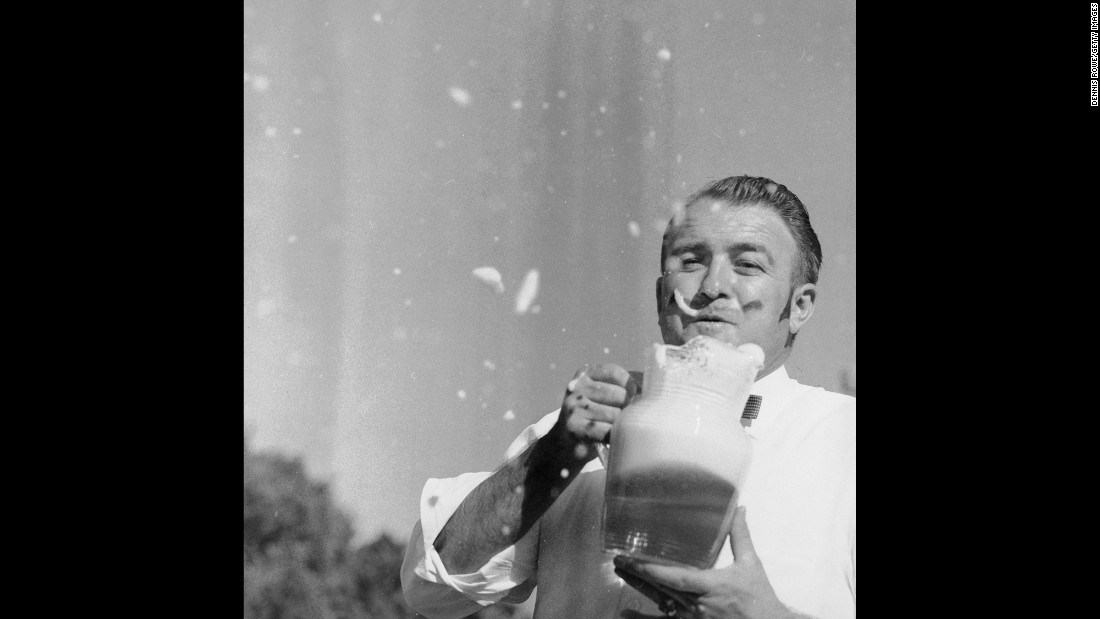 A man drinks a stein of beer at an Oktoberfest event in Monterey, California, in 1958. Many other countries put on their own Oktoberfest celebrations in honor of the main event in Germany.