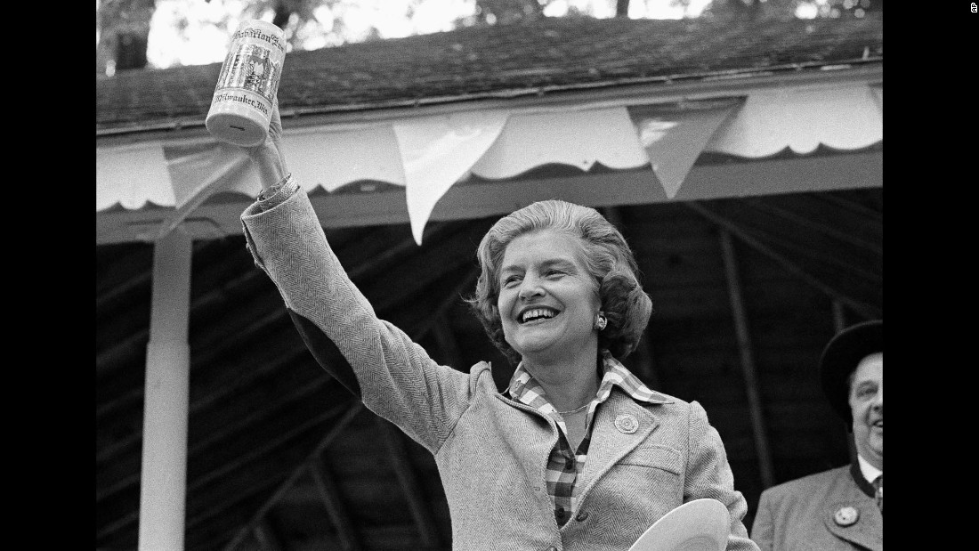 U.S. first lady Betty Ford holds a beer mug she received at an Oktoberfest event in Milwaukee in 1976.