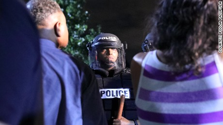 Police officers face off with protestors, September 21, in Charlotte, North Carolina.