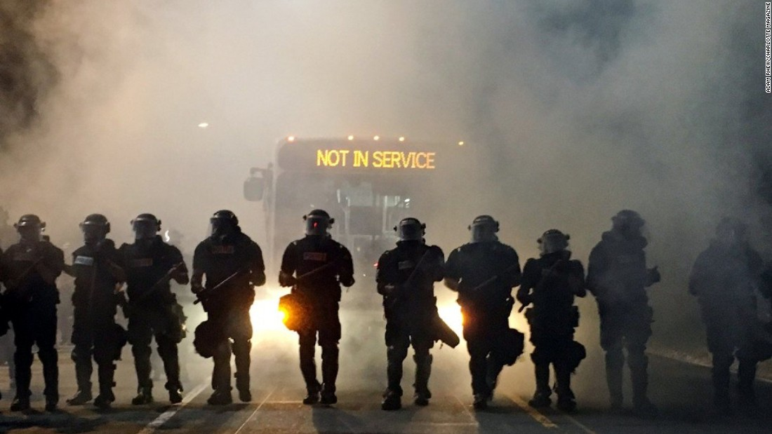 Police stand guard on the first night of protests.