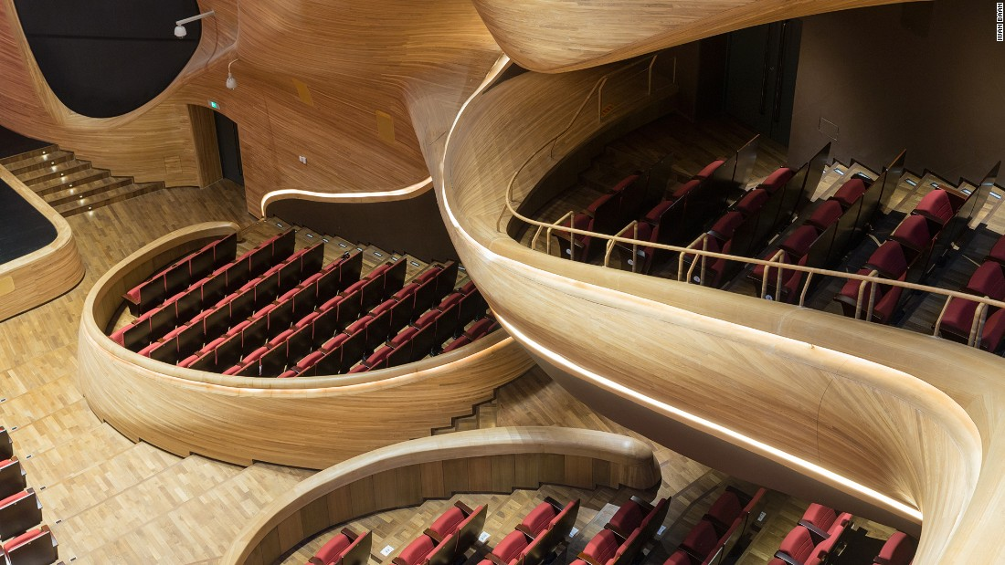 Curvature is a defining feature of the building, which welcomes visitors who aren't necessarily there to see an opera.