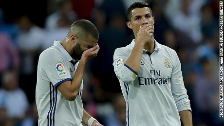 MADRID, SPAIN - SEPTEMBER 21: Cristiano Ronaldo (R) of Real Madrid CF and his teammate Karim Benzema (L) reacts after Villarreal CF player Bruno Soriano's opening goal during the La Liga match between Real Madrid CF and Villarreal CF at Santiago Bernabeu stadium on September 21, 2016 in Madrid, Spain. (Photo by Gonzalo Arroyo Moreno/Getty Images)