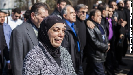 Mourners in Raleigh, North Carolina, grieve the shooting deaths of three Muslim students in Chapel Hill in 2015.