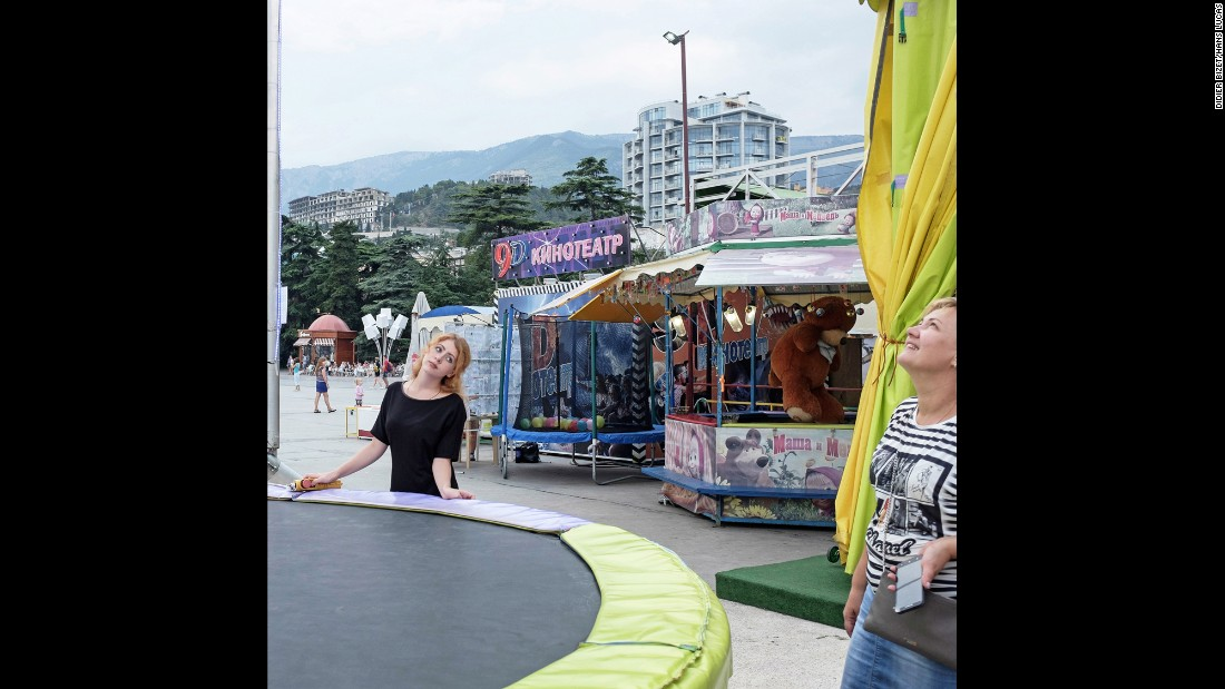 Booths are set up at a fair on Yalta's Lenin Promenade.