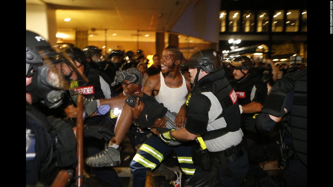 "Police officers and protesters carry a man who was shot <a href=""http://www.cnn.com/2016/09/21/us/charlotte-police-shooting/"" target=""_blank"">during a second night of protests</a> in Charlotte, North Carolina, on Wednesday, September 21. The shooting victim, 26-year-old Justin Carr, later died. The city said he was shot by another civilian. <a href=""http://www.cnn.com/2016/09/21/us/gallery/charlotte-protest/index.html"" target=""_blank"">Violent protests erupted in Charlotte</a> following the death of Keith Lamont Scott, who was shot by police in an apartment complex parking lot. Charlotte-Mecklenburg Police Chief Kerr Putney said Scott exited his car with a gun and that he was shot after he wouldn't drop it. Scott's family said he was unarmed and sitting in his car reading a book."