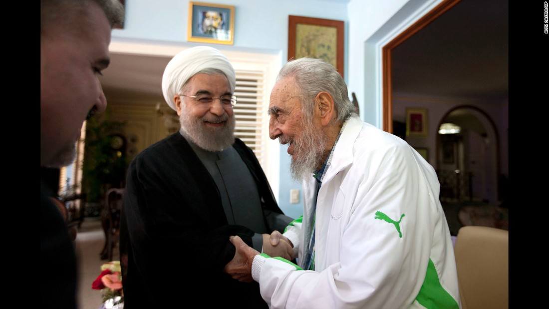 Iranian President Hassan Rouhani, center, shakes hands with former Cuban leader Fidel Castro during a visit to Havana, Cuba, on Monday, September 19.