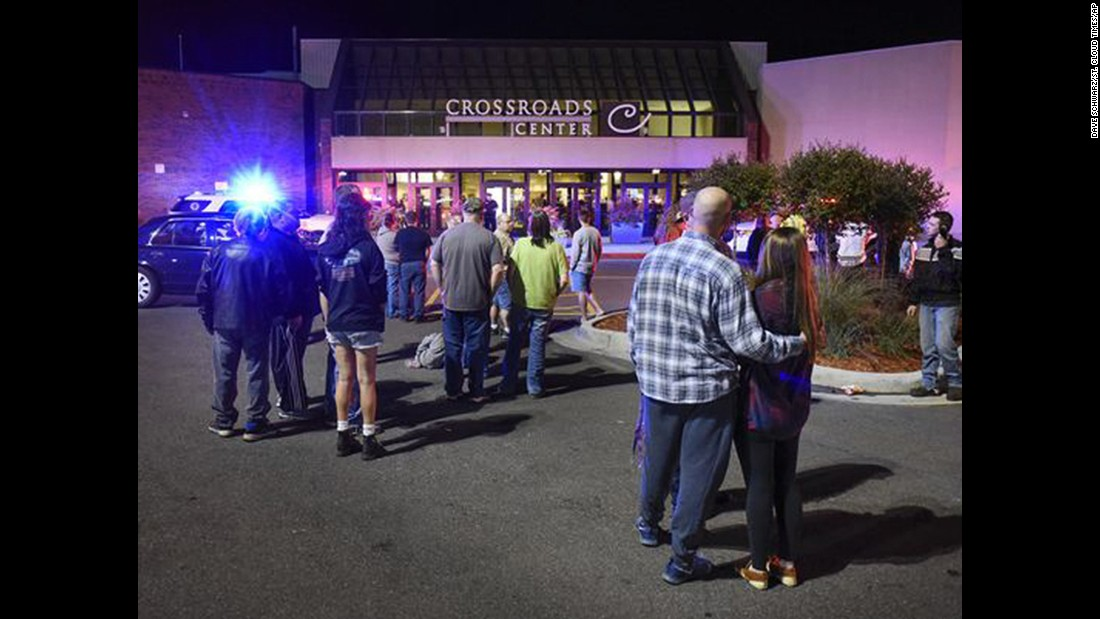 "People stand near an entrance of the Crossroads Center mall after <a href=""http://www.cnn.com/2016/09/19/us/minnesota-mall-stabbing/"" target=""_blank"">multiple people were stabbed</a> there Saturday, September 17, in St. Cloud, Minnesota. Dahir Adan is suspected of storming the mall and injuring 10 people before he was shot dead by an off-duty police officer."