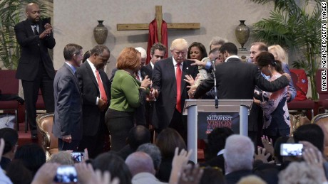 TOPSHOT - Pastors and attendees lay hands and pray over Republican presidential nominee Donald Trump during the Midwest Vision and Values Pastors and Leadership Conference at the New Spirit Revival Center in Cleveland Heights, Ohio on September 21, 2016. / AFP PHOTO / MANDEL NGANMANDEL NGAN/AFP/Getty Images