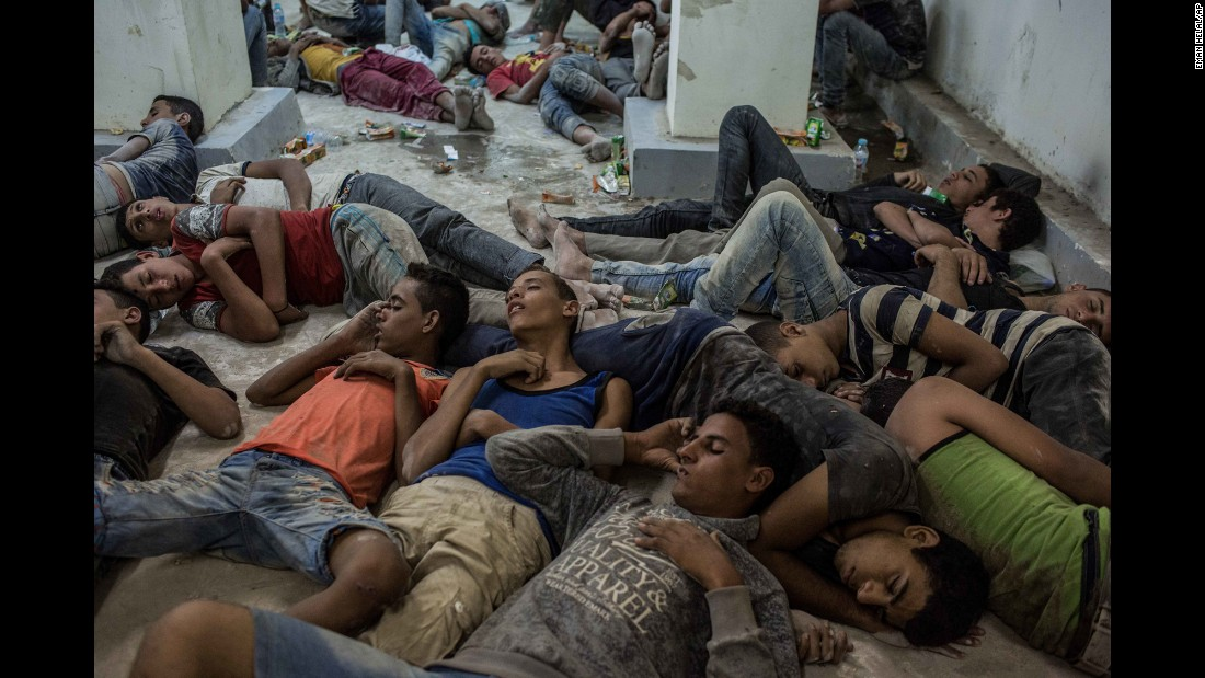 "Young people sleep on a police station floor in Rosetta, Egypt, after being rescued from <a href=""http://www.cnn.com/2016/09/22/middleeast/migrant-boat-capsize-egypt-arrests/"" target=""_blank"">a capsized boat</a> off the Mediterranean coast on Wednesday, September 21. <a href=""http://www.cnn.com/2015/09/03/world/gallery/europes-refugee-crisis/index.html"" target=""_blank"">Europe's migration crisis in 25 photos</a>"
