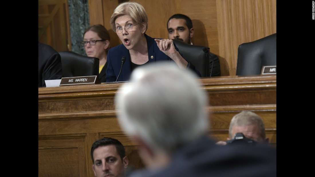 "US Sen. Elizabeth Warren, a member of the Senate Banking Committee, questions Wells Fargo Chief Executive John Stumpf in Washington on Tuesday, September 20. Warren <a href=""http://money.cnn.com/2016/09/22/investing/wells-fargo-elizabeth-warren-fair-labor-firings/"" target=""_blank"">unleashed a verbal barrage at Stumpf,</a> calling the embattled bank boss ""gutless"" and demanding he step down. Her diatribe was the most forceful condemnation yet of Wells Fargo, which fired more than 5,000 employees over the past few years for creating fake accounts without customer knowledge. The employees created the fraudulent accounts to meet bank quotas and were allegedly threatened with firing if they didn't comply."