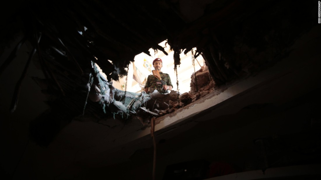 "A soldier looks through a damaged building in Sanaa, Yemen, after an airstrike by the Saudi-led coalition on Tuesday, September 20. Yemen's Houthi rebels, who are Shiite, <a href=""http://www.cnn.com/2016/01/18/middleeast/yemen-violence/"" target=""_blank"">rebelled last year</a> against the Sunni-led government of President Abdu Rabu Mansour Hadi, which is backed by Saudi Arabia. Saudi Arabia got involved by launching airstrikes against rebel targets in Yemen."