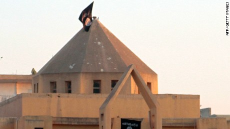 The flag of ISIS flutters over a building in Raqqa, Syria.