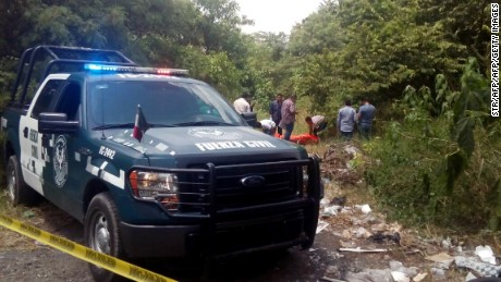 Forensic personnel and policemen recover the corpses of catholics priests Alejo Nabor Jimenez Juarez and Jose Alfredo Juarez de la Cruz who were kidnapped by gunmen from Nuestra Senora de Fatima Chuch in Poza Rica, Veracruz state, Mexico on September 19, 2016. The corpses of alleged priests were found tied hands and with several bullet wounds. / AFP / STR        (Photo credit should read STR/AFP/Getty Images)