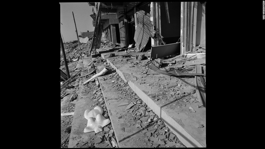Part of a mannequin lies outside destroyed shops in Sinjar.