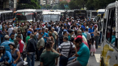 Employers of public transportation block a main avenue in Caracas during a protest due to the shortage in Venezuela of spare parts for their vehicles on September 21, 2016. Oil-rich Venezuela has veered into crisis as crude prices have collapsed since mid-2014, threatening president Nicolas Maduro and 17 years of socialist rule. / AFP / JUAN BARRETO        (Photo credit should read JUAN BARRETO/AFP/Getty Images)