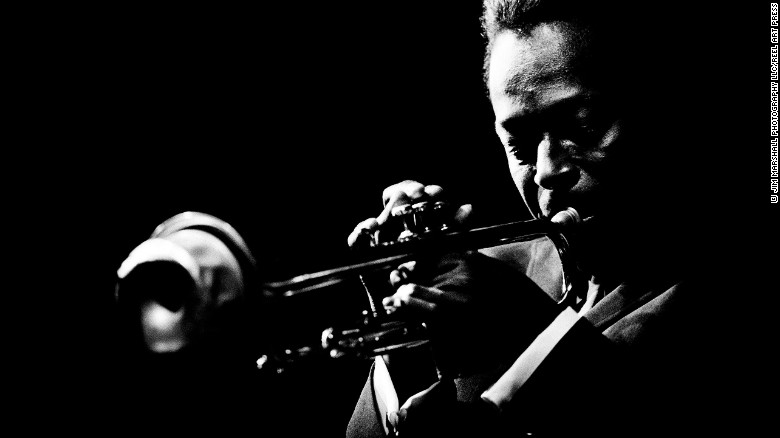 """Miles Davis plays the trumpet at the Monterey Jazz Festival in Monterey, California, in 1964. It's one of the images in a new book, """"Jazz Festival"""" by legendary music photographer Jim Marshall."""