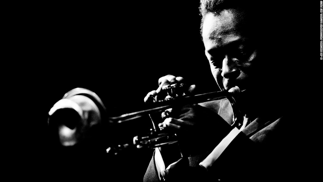 """Miles Davis plays the trumpet at the Monterey Jazz Festival in Monterey, California, in 1964. It's one of the images in a new book, <a href=""""http://www.reelartpress.com/catalog/edition/90/jazz-festival-jim-marshall"""" target=""""_blank"""">""""Jazz Festival""""</a> by legendary music photographer Jim Marshall."""