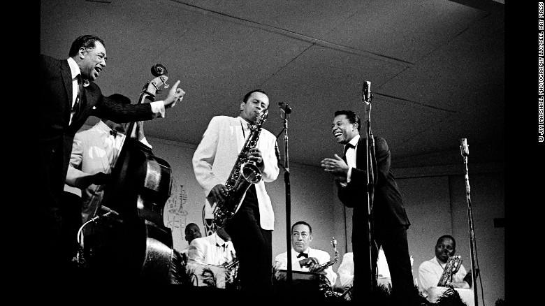 Duke Ellington, left, performs with saxophonist Paul Gonsalves, center, at the Monterey Jazz Festival in 1960.