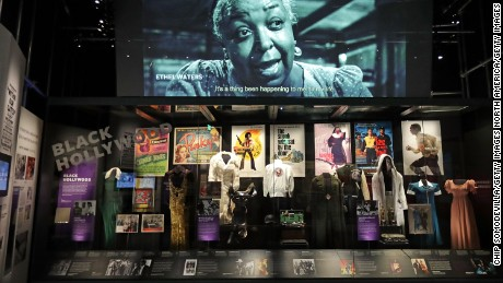 Costumes, props, posters and other artifacts on display in the Taking the Stage section of the museum
