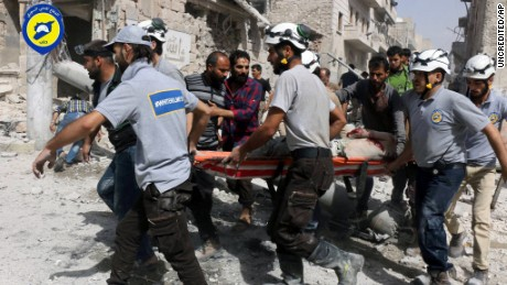 Rescue workers in the al-Sakhour neighborhood, eastern Aleppo, Syria, Wednesday Sept. 21, 2016.
