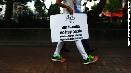 Catholic activists march to protest against President Enrique Pena Nieto proposal to legalize same-sex marriage, in Guadalajara, Mexico, on September 10, 2016. Pena Nieto proposed -last May- a constitutional reform that would legalize same-sex marriage nationwide after the Supreme Court ruled last year that state bans were unconstitutional. Currently only a handful of the country's 31 states and Mexico City allow such weddings. / AFP / Hector GUERRERO        (Photo credit should read HECTOR GUERRERO/AFP/Getty Images)