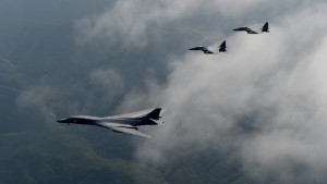 A U.S. Air Force B-1B Lancer, deployed to Andersen Air Base, Guam, is flanked by two F-15K Slam Eagles, assigned to Daegu Air Base, South Korea, during a flight over South Korea Sept. 21, 2016. The B-1 is the backbone of the U.S. long-range bomber mission and is capable of carrying the largest payload of both guided and unguided weapons in the Air Force inventory. (South Korean air force photo/Chief Master Sgt. Kim, Kyeong Ryul)