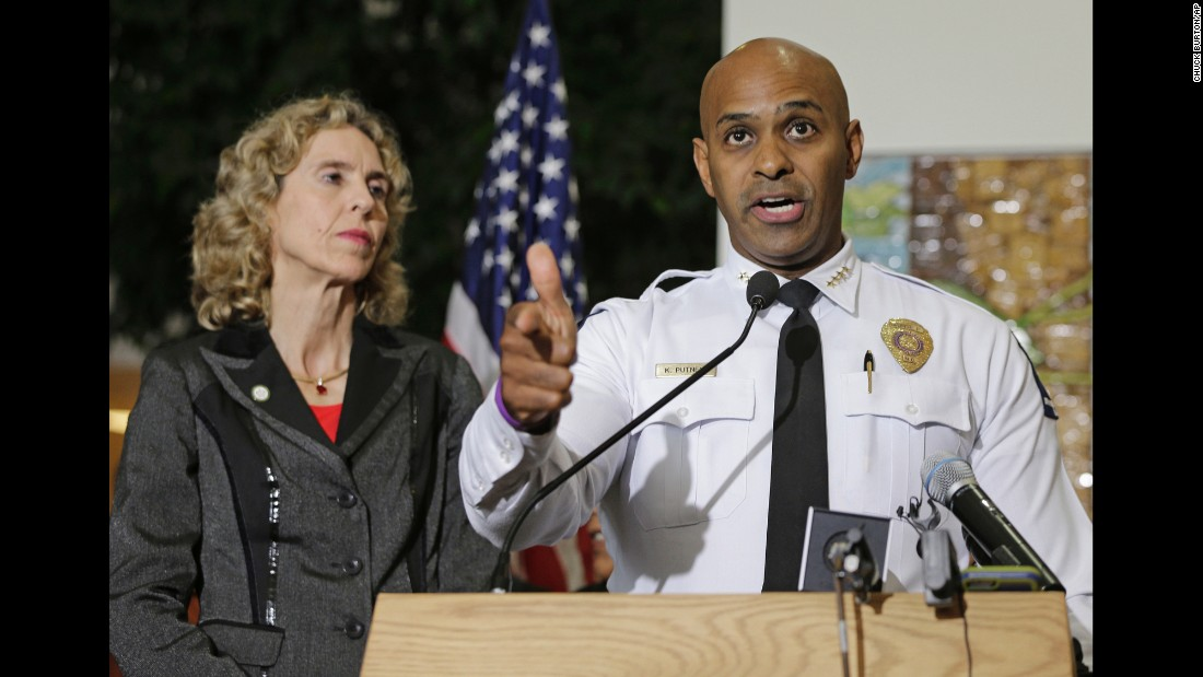 "Jennifer Roberts, the mayor of Charlotte, North Carolina, watches Charlotte-Mecklenburg Police Chief Kerr Putney speak at a news conference on Thursday, September 22. <a href=""http://www.cnn.com/2016/09/21/us/gallery/charlotte-protest/index.html"" target=""_blank"">Violent protests erupted</a> the night before following the death of Keith Lamont Scott, who was shot by a police officer in an apartment complex parking lot. Putney said Scott exited his car with a gun and that he was shot after he wouldn't drop it. Scott's family said he was unarmed and sitting in his car reading a book."