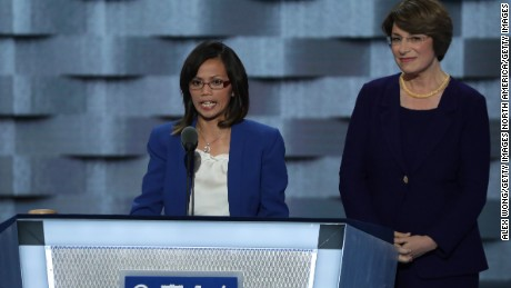 Ima Matul speaks at the Democratic National Convention, alongside  Senator Amy Klobuchar.