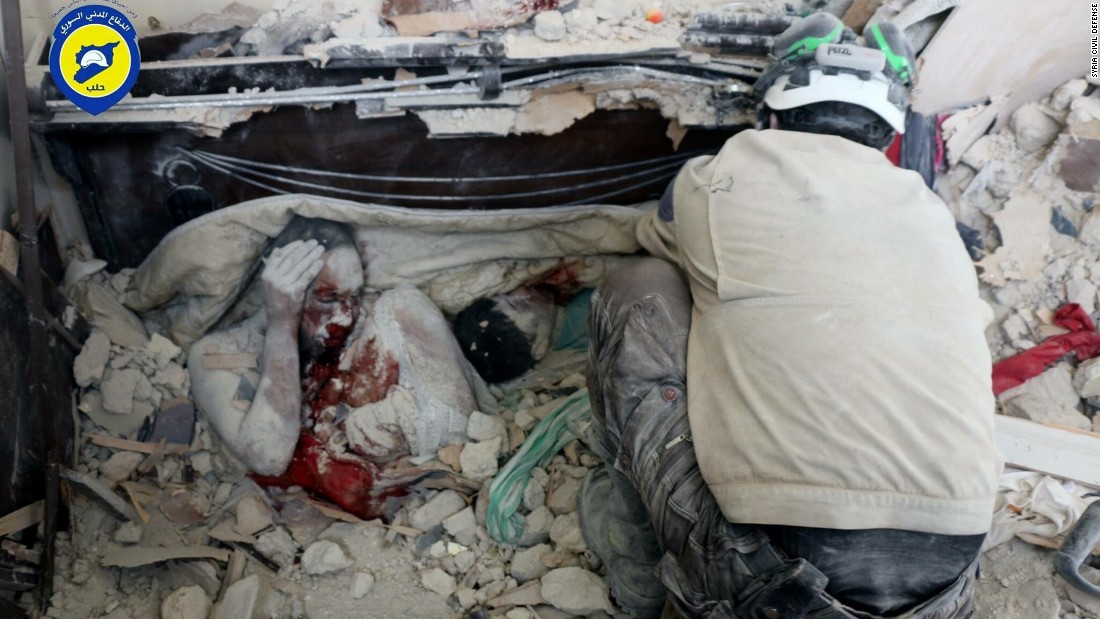 Brahim Sawas and his 10-year- old son, Mahmoud, fell victim to the war in Syria on Friday, September 23, in eastern Aleppo. They were covered in blood and dust, the pressure of rubble holding their final postures in place.