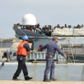 east african refugees arrive italy 1