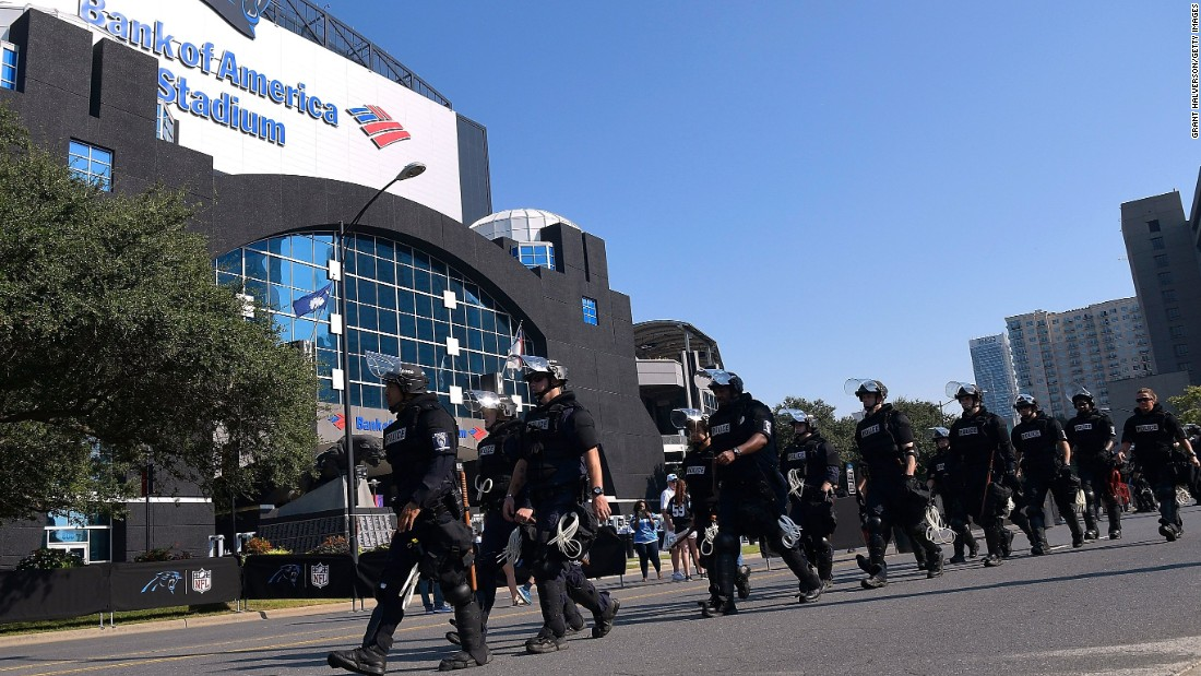 Charlotte-Mecklenburg police officers arrive outside of Bank of America Stadium prior to the Panthers game on September 25.