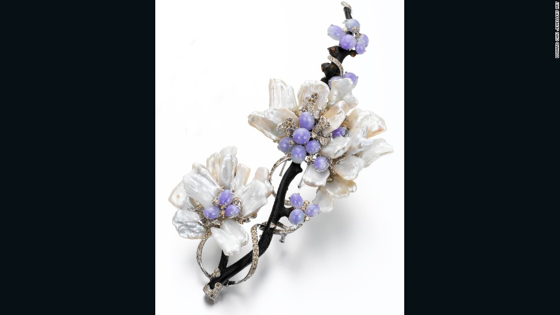 An 18K white gold brooch made with lavender jadeite, black coral, pearl and diamonds from Edward Chiu Jewellery Art.