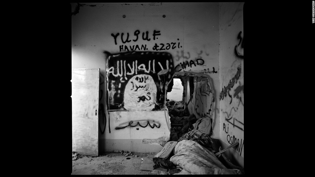 This house was used by ISIS militants in Sinjar. It has Islamic graffiti and tunnels blasted through the walls.