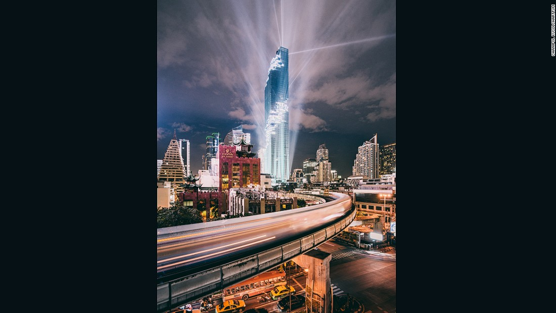"This photo was taken during the recent grand opening event at Thailand's new tallest building, MahaNakhon Tower. ""The light show was epic,"" says Chanipol."