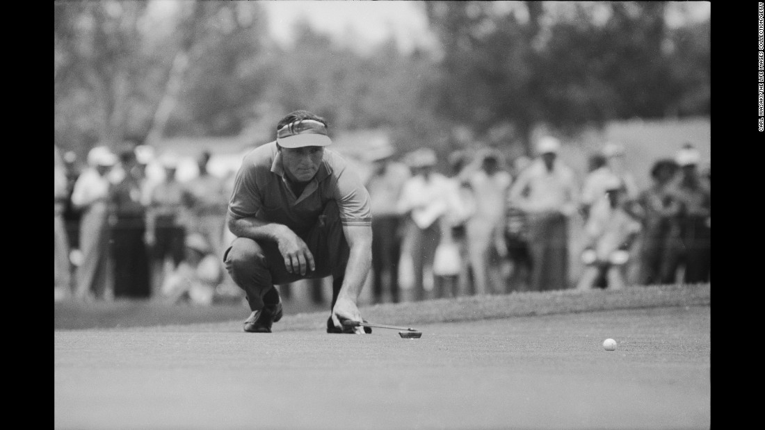 Palmer crouches as he lines up a shot at the Cherry Hills Country Club during the US Open Championship at Cherry Hills Village near Denver, Colorado, in June 1960.