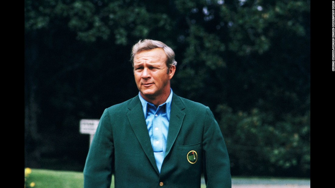 Palmer donning his green jacket during the 1973 Masters.