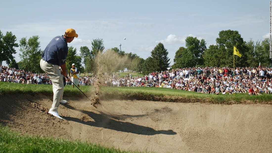 That year Rich Beem -- pictured hitting out of the bunker at hole No. 8 -- was a surprise champion, with Tiger Woods runner-up. It would be Beem's only major title.