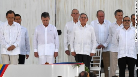 "(L-R, forst row) UN Secretary General Ban Ki-moon, Colombian President Juan Manuel Santos, Cuban President Raul Castro, and the head of the FARC guerrilla Timoleon Jimenez, aka Timochenko, are pictured during the signing of the historic peace agreement between the Colombian government and the Revolutionary Armed Forces of Colombia (FARC), in Cartagena, Colombia, on September 26, 2016  Colombia will turn the page on a half-century conflict that has stained its modern history with blood when the FARC rebels and the government sign a peace deal on Monday. President Juan Manuel Santos and the leader of the FARC, Rodrigo Londono -- better known by his nom de guerre, Timoleon ""Timochenko"" Jimenez -- are set to sign the accord at 2200 GMT in a ceremony in the colorful colonial city of Cartagena on the Caribbean coast. / AFP / Luis ACOSTA        (Photo credit should read LUIS ACOSTA/AFP/Getty Images)"