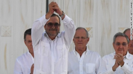 "The head of the FARC guerrilla Timoleon Jimenez, aka Timochenko, gestures as he signs the historic peace agreement between the Colombian government and the Revolutionary Armed Forces of Colombia (FARC), in Cartagena, Colombia, on September 26, 2016  Colombia will turn the page on a half-century conflict that has stained its modern history with blood when the FARC rebels and the government sign a peace deal on Monday. President Juan Manuel Santos and the leader of the FARC, Rodrigo Londono -- better known by his nom de guerre, Timoleon ""Timochenko"" Jimenez -- are set to sign the accord at 2200 GMT in a ceremony in the colorful colonial city of Cartagena on the Caribbean coast. / AFP / Luis Acosta        (Photo credit should read LUIS ACOSTA/AFP/Getty Images)"