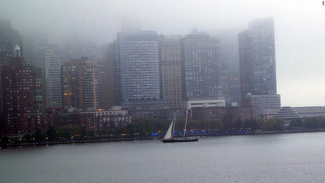 They came into port early in the morning, and the mist covered the tops of Manhattan's skyscrapers.