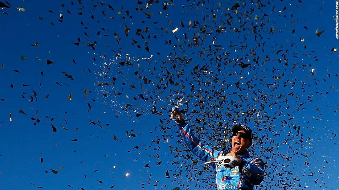 Confetti falls around NASCAR driver Kevin Harvick after he won a Sprint Cup race in Loudon, New Hampshire, on Sunday, September 25. The victory clinched him a spot in the second round of the Chase for the Cup.