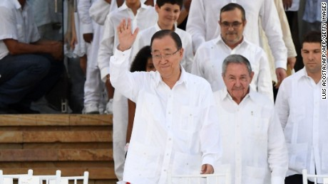 "UN Secretary General Ban Ki-moon (L) waves next to Cuban President Raul Castro (C) and other world leaders and of the head of the FARC guerrilla Timoleon Jimenez, aka Timochenko (C, second row), before the signing of the historic peace agreement between the Colombian government and the Revolutionary Armed Forces of Colombia (FARC), in Cartagena, Colombia, on September 26, 2016  Colombia will turn the page on a half-century conflict that has stained its modern history with blood when the FARC rebels and the government sign a peace deal on Monday. President Juan Manuel Santos and the leader of the FARC, Rodrigo Londono -- better known by his nom de guerre, Timoleon ""Timochenko"" Jimenez -- are set to sign the accord at 2200 GMT in a ceremony in the colorful colonial city of Cartagena on the Caribbean coast. / AFP / Luis ACOSTA        (Photo credit should read LUIS ACOSTA/AFP/Getty Images)"