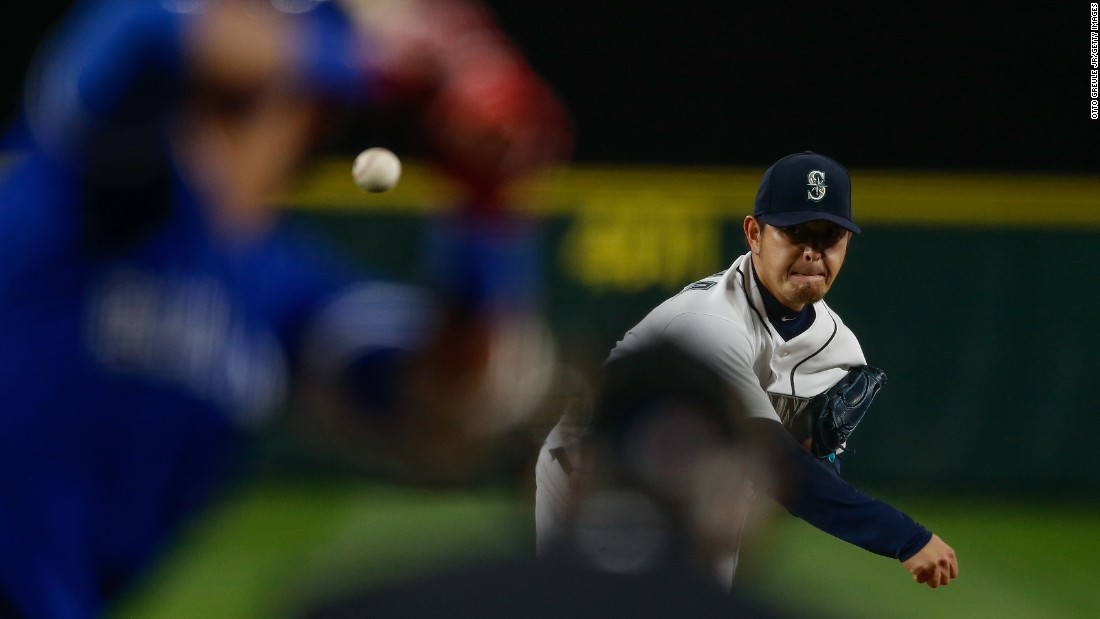 Seattle pitcher Hisashi Iwakuma throws the ball to a Toronto batter during a Major League Baseball game on Tuesday, September 20.