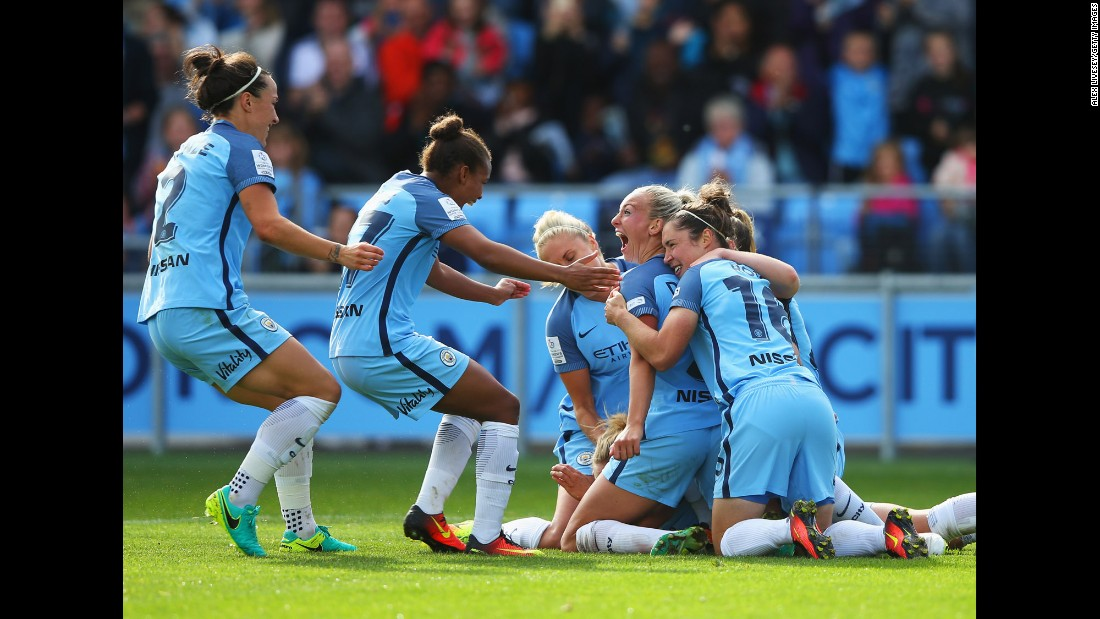 Manchester City players celebrate a goal against Chelsea during a Women's Super League match in Manchester, England, on Sunday, September 25. Manchester City won 2-0 to clinch its first league title.