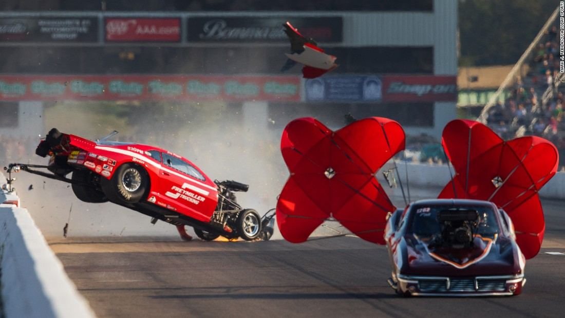 The car of drag racer Jay Payne goes airborne during a race against Chuck Little in Madison, Illinois, on Friday, September 23. Payne walked away from the crash.