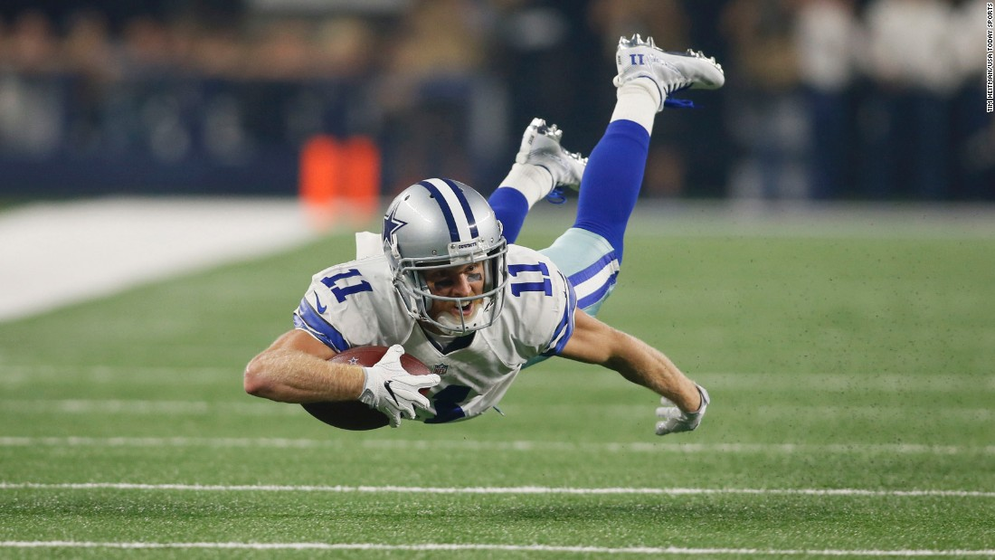 Dallas wide receiver Cole Beasley dives for more yards after a catch against Chicago on Sunday, September 25. Beasley had seven receptions in the 31-17 victory.