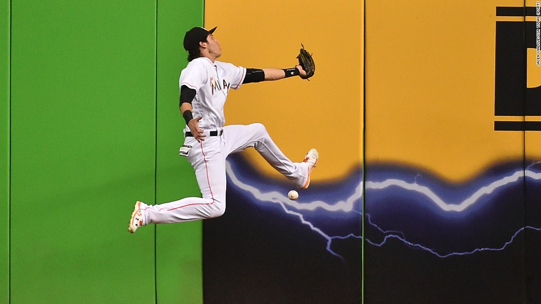 Miami left fielder Christian Yelich misplays a fly ball during a home game against Atlanta on Thursday, September 22.